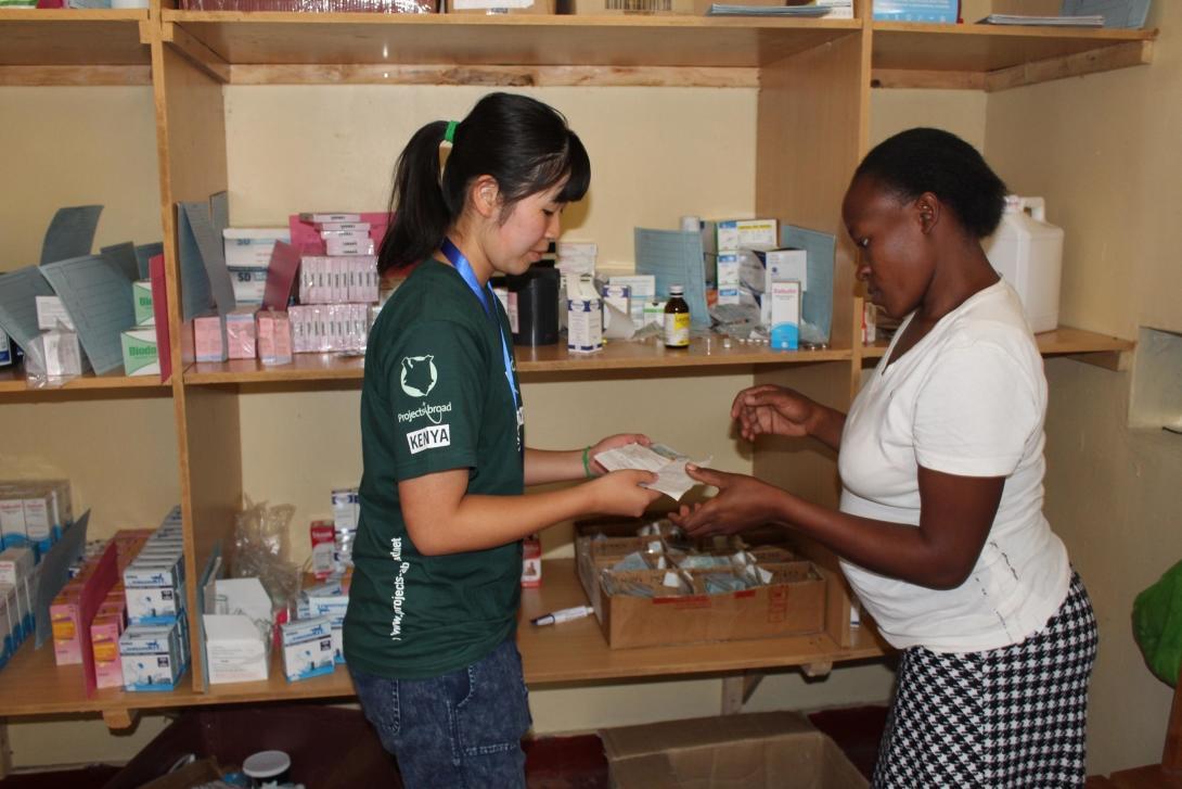 A Medicine volunteer assists at a mobile dispensary in Kenya